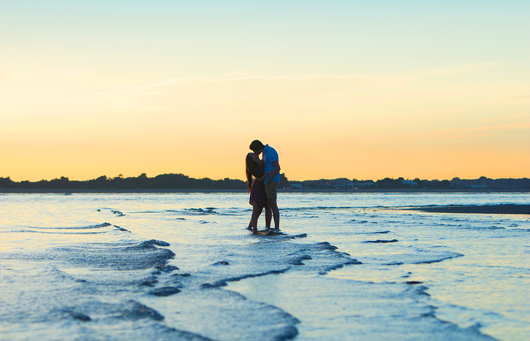 Couple kissing in the ocean